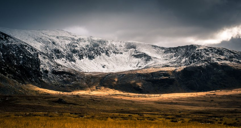 A landscape image of mount snowdon covered in snow during the winter in North wales